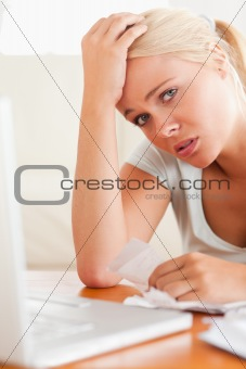 Worried woman doing paperwork