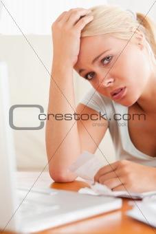 Worried woman doing paperwork