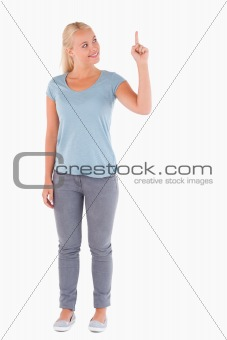 Blond woman pointing at copyspace