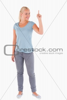 Charming woman pointing at copyspace