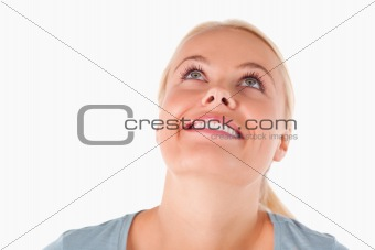 Smiling blond woman looking at the ceiling