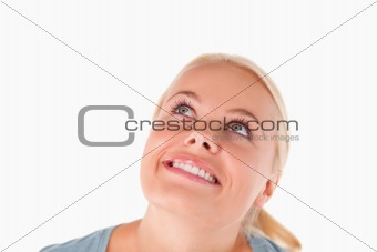 Charming blond woman looking at the ceiling