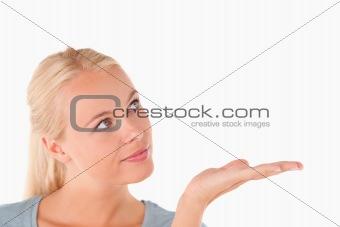 Cute woman showing copyspace