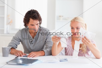 Couple in despair while doing their acconts