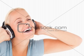 Close up of a laughing woman with headphones