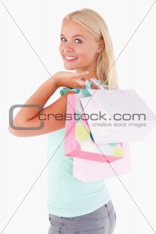 Close up of a Joyful woman with some shopping bags