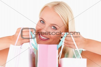 Close up of a woman holding bags
