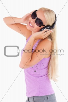 Cute woman with earphones and sunglasses