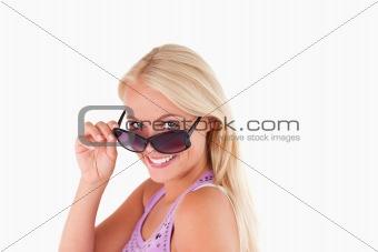 Blond lady peeking over her sunglasses