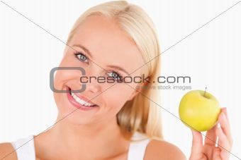 Charming woman holding an apple