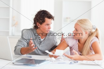 Couple arguing on expenses