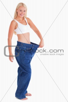 Charming woman wearing jeans that are too big