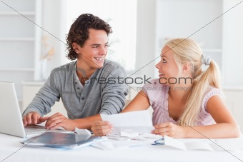Surprised couple doing their accounts