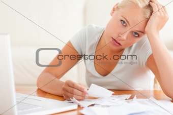 Despaired woman accounting looking into the camera