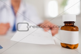 Female doctor showing paper