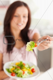 A woman offers salad