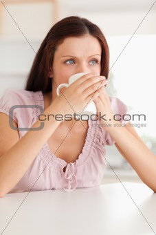 Thoughtful woman drinking