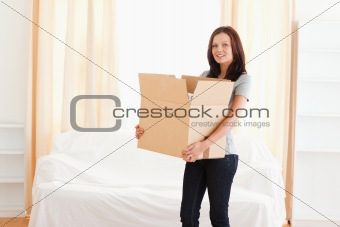 Woman carrying cardboard