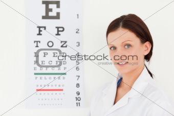 Female optician with eye test