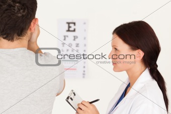 Female optician and man