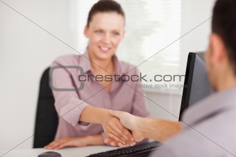 A businesswoman shakes hands