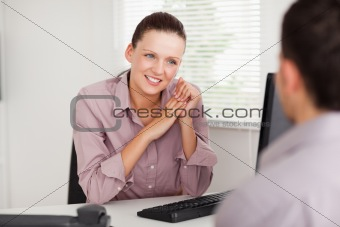 Businesswoman talking with customer