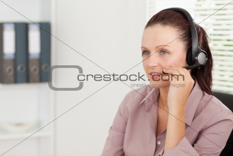 An operator with headset in an office