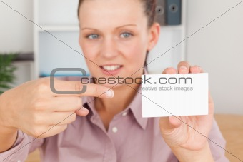 Business woman pointing at a card
