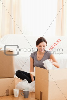 Cute woman packing her things