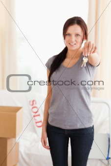 Portrait of a Cute woman holding keys
