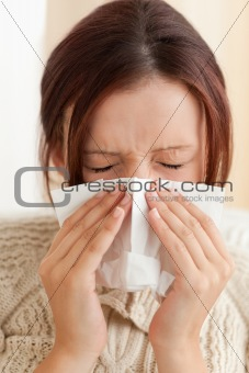 Sneezing young woman