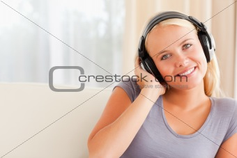 Close up of a smiling woman enjoying some music