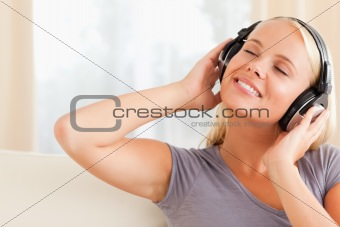 Close up of a pleased woman enjoying some music