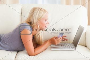 Beautiful woman purchasing online