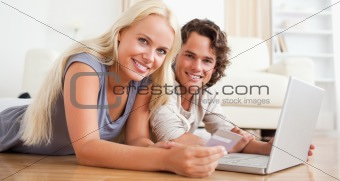 Couple booking their holidays online