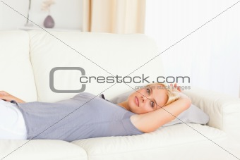 Calm woman lying on a sofa
