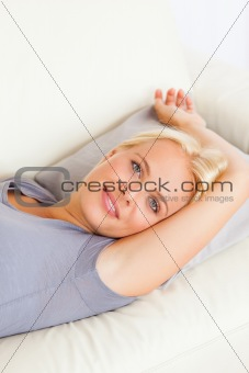 Portrait of gorgeous woman lying on a sofa