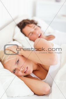Portrait of an angry woman awaken by her boyfriend's snoring