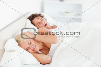 Annoyed woman awaken by her boyfriend's snoring