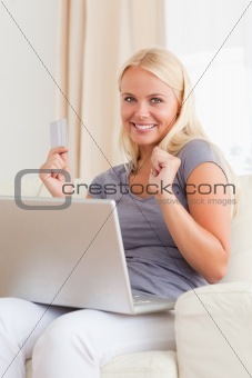Portrait of a beautiful blond woman shopping online