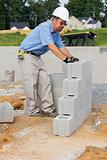 Mason with Concrete Block
