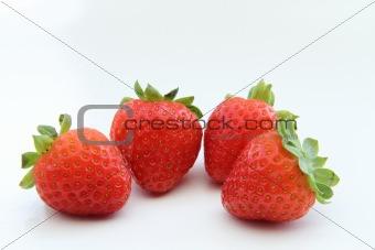 four juicy strawberries