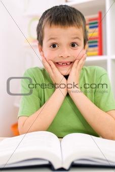 Little boy forgot reading - back to school concept