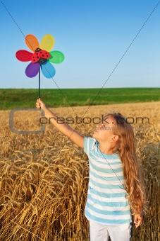 Little girl playing outdoors in summer time