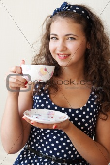 Beautiful young brunette holding a large cup