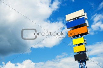 A blank billboard with blue sky in the background