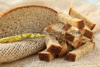 rye bread croutons on linseed bag, rustic style