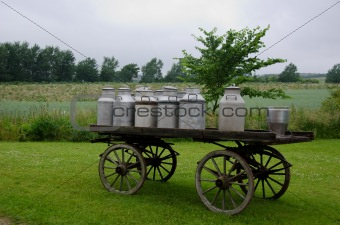 Old milk cans on waggon