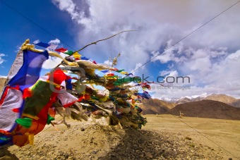 prayer flags on himalayas and blue sky background