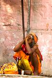 sadhu (holy man) smokes a pipe